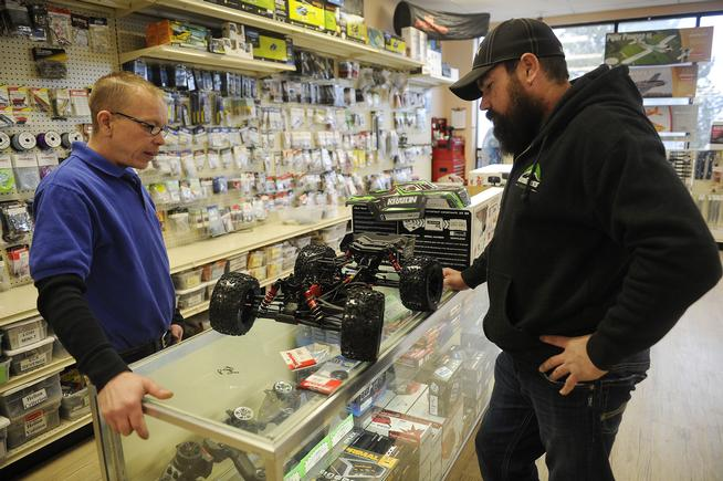 AURORA, CO - FEBRUARY 5: Vincent Esch, left, and Daniel Davis look over a Kraton 6s RC truck at HobbyTown USA in Aurora, Colorado on February 5, 2015. HobbyTown USA carries a wide variety of items to cover nearly all hobbies including RC vehicles, quadcopters, model train and slot car racing. (Photo by Seth McConnell/The Denver Post)